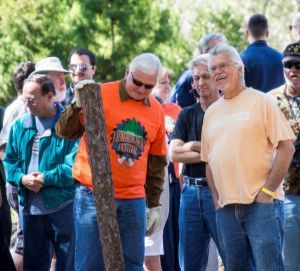 Pensacola State College President Ed Meadows (orange shirt) checks out the forestry competitions at the 2016 Lumberjack Festival.